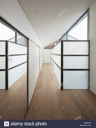 interior of a modern house long corridor with wall closets stock