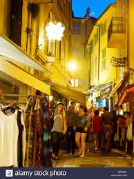 tourists visit local shops in cannes old city center the city is