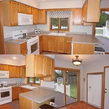 kitchen backsplash with oak cabinets and white appliances green walls oak cabinets backsplash