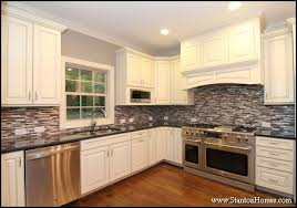8 examples of white kitchen cabinets with black granite photos
