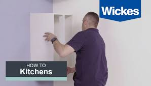 how to hang a cabinet to the wall how to hang wall cabinets with wickes