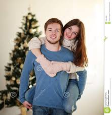 At Home Christmas Trees by Happy Winter Couple In Love At Home On Background Christmas Tree