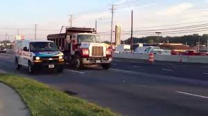 mack and volvo trucks mack r686st and white gmc volvo wca64 dump trucks youtube