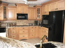 brown kitchen interior with black appliance with recessed