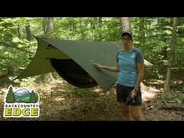 camping hammock shelter comparison with included bug net and rainfly