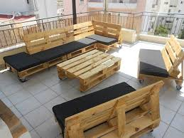 awesome rooftop patio with wooden table plus sofa and wheeled