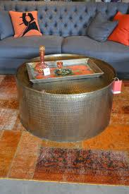 silver tufted sofa silver color round hammered metal tray coffee table for living
