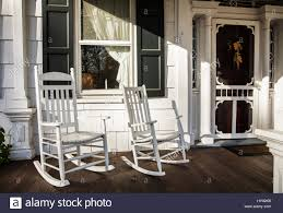 White Rocking Chair Old Fashioned Front Porch Two White Rocking Chairs Window And