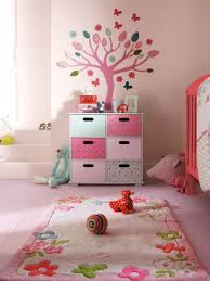 baby room with floral rug ideas for kids room also tree wall