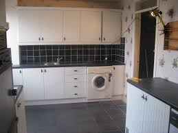 kitchen feature wall ideas white cabinets black appliances grey