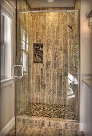 river rock bathroom ideas river rock shower and wood grained tile floor bathroom remodel in