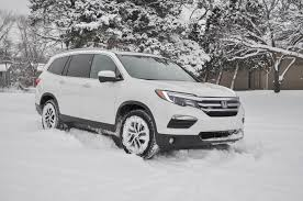 lexus vs honda pilot 2016 honda pilot long term road test handling winter weather