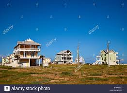 wooden house on stilts on beach front galveston texas usa stock