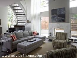 sofa and wall with white staricase in living room