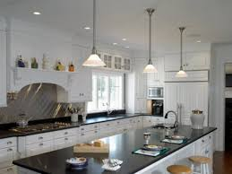 spacing pendant lights over kitchen island birdcage shapes