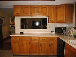 u shaped kitchen plan design with oak cabinet using cream granite