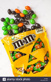 free halloween images on white background open bag of peanut m u0026ms spooky colours with contents spilled for