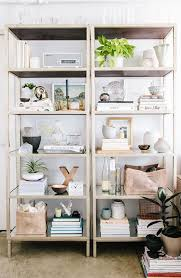 how to style a bookcase how to style a bookshelf the lv guide