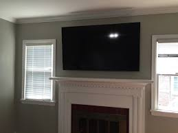 decoration charming mounting a tv over a fireplace with interior