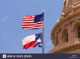 Texas State Flag Us And Texas Flags Flying Over Texas State Capitol Building Austin