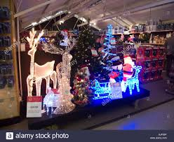 christmas decorations on display in uk garden centre stock photo