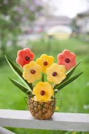 pineapple tree centerpiece with fruit monkeys fruit displays