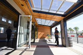 this modern prefab reflect home has windows that double as solar