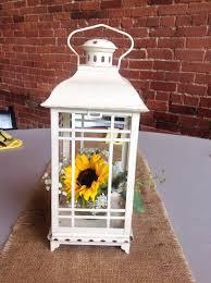 White Lantern Centerpieces by White Lantern With A Sunflower Arrangement Inside Centerpieces