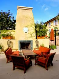 simple patio design with coastal fireplace with high chimney part