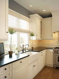 Traditional Kitchen With Farmhouse Sink By Kimberly West Zillow - Shaw farmhouse kitchen sink