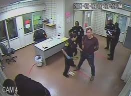 watch austin officer who staged death processed after dallas