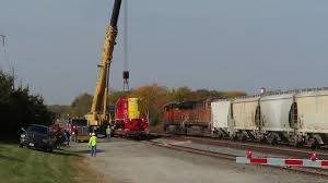 bnsf cement train passes engine getting prepped for crane lift