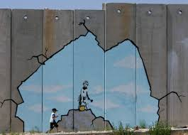 who is banksy new mathematical analysis claims to know pbs newshour a palestinian boy walks past a drawing by british graffiti artist banksy along part of