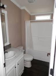 rockville 26 x 44 1158 sqft mobile home factory expo home centers the rockville bathroom shown with elongated china commode one piece tub shower comination calcutta marble counter tops and optional 3 inch cove molding