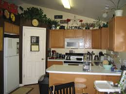 ideas for decorating space above cabinets in kitchen room design