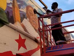a dc mural honors 16 african american heroes throughout history when udofia was asked to refurbish his five year old mural that formerly covered ben ali way he sought to focus on the new figures historical impact on