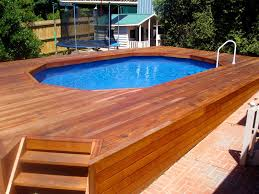 architecture swimming pool decor with oval pool and brown wood