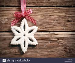 white christmas snowflake decoration hanging from a fresh red and