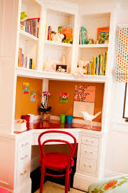 cozy desk plus floating shelfs and cute drawer closed red chair as