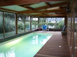 Photo De Piscine En Bois A Port Blanc Grande Et Chaleureuse Maison En Bois Piscine Couverte