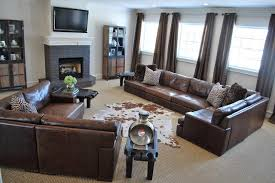 family room living room dk brown leather sofa large jute area rug