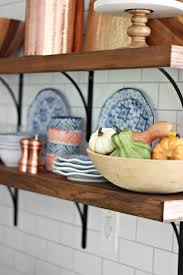 fall decor to our open shelving in the kitchen
