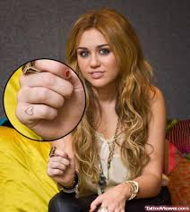 miley cyrus showing her finger heart tattoo tattoo viewer com
