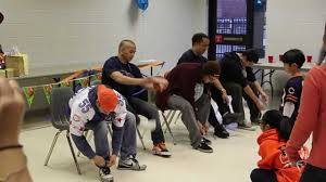 baby shower game men with balloons tie your shoes youtube