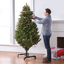 the remote controlled height adjustable christmas tree hammacher