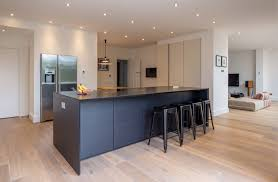 kitchen with island and breakfast bar modern black kitchen island breakfast bar integrated fridge