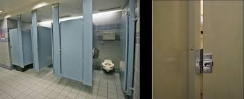 usa why do public toilets in the us have large gaps no privacy