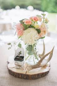 wedding table flower centerpieces rustic wedding table decor ideas anltler and flower centerpieces