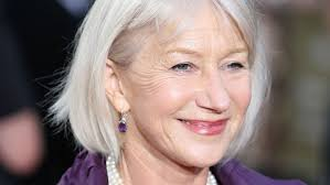 older women with platinum blonde pink hair going grey gracefully how to manage the transition to grey hair