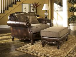 Ashley Sofa Leather by Ashley 8430314 Claremore Antique Faux Leather Ottoman With Fabric Seat